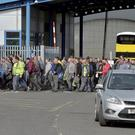 Workers leave the Wrightbus plant today in Ballymena. Stephen Hamilton / Press Eye