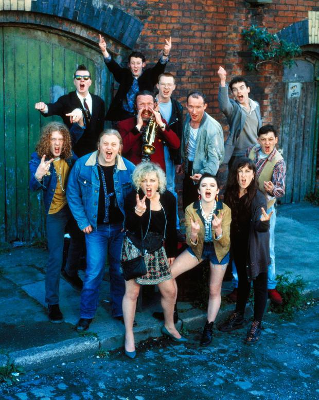 The Commitments (1991). Shown front row from left: Glen Hansard, Andrew Strong, Angeline Ball, Bronagh Gallagher, Maria Doyle, Kenneth McClusky; back row from left: Felim Gormley, Robert Arkins, Johnny Murphy, Dick Massey, Dave Finnegan, Michael Aherne.