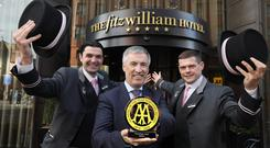Cian Landers, general manager of the Fitzwilliam Hotel (centre) celebrates its latest accolade of AA Hotel of the Year