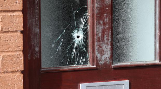 The scene at Cherry Walk in Dunmurry where a shot was fired through the front door of a property on Thursday night. Picture by Jonathan Porter/PressEye