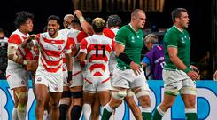 Japan players (L) celebrate scoring a try during the Japan 2019 Rugby World Cup Pool A match between Japan and Ireland at the Shizuoka Stadium Ecopa in Shizuoka on September 28, 2019. (Photo by William WEST / AFP)WILLIAM WEST/AFP/Getty Images