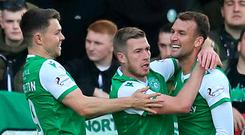 Hibernian players celebrate after Kristoffer Ajer's own goal opened the scores at Easter Road.