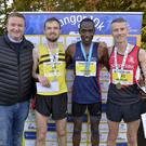 Stephen Patton from Belfast City Airport pictured with Winner Gideon Kipsang pictured with 2nd Declan Reed and 3rd Conan McCaughey.