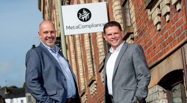 Pictured (L-R) are John Hood, Multi Sector Director, Invest Northern Ireland with Robert O'Brien, Chief Executive, MetaCompliance.