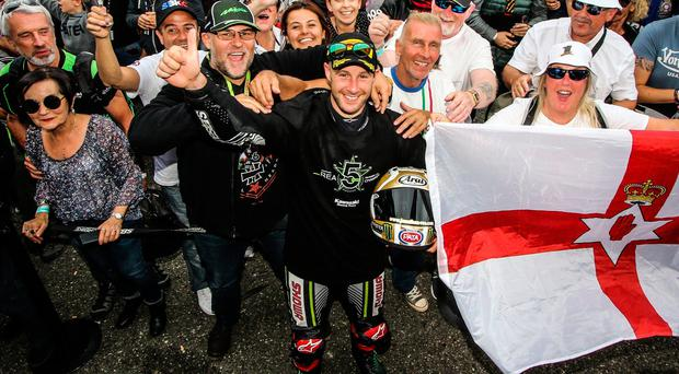 Flying flag: Jonathan Rea celebrates with fans after clinching his fifth consecutive World Superbike crown