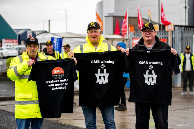 Harland and Wolff workers holds t-shirts from the GMB union following the announcement that the Belfast shipyard has been saved after it was bought for £6 million by InfraStrata, a company that works on energy infrastructure projects. PA Photo. Picture date: Tuesday October 1, 2019.