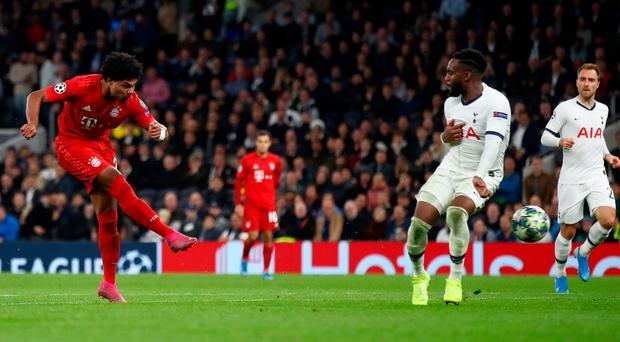 Seven up: Serge Gnabry slots in Bayern's seventh goal