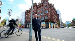 Lawrence Kenwright at the site for the proposed George Best Hotel