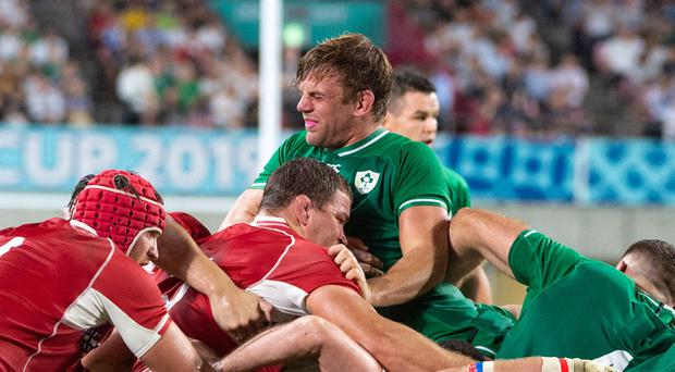 Jordi Murphy gets crushed in a scrum, picking up a rib injury tat ended his first World Cup game after only 26 minutes.