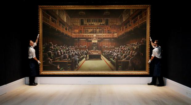 A Banksy artwork depicting MPs in the House of Commons as chimpanzees has been sold for £9.9 million (Jonathan Brady/PA)