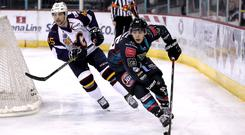Belfast Giants winger Patryk Wronka skates away from Guildford Flames defenceman Steve Lee (William Cherry/Presseye)