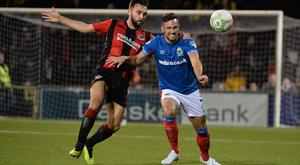 Linfield's Andy Waterworth and Crusaders Chris Hegarty during this evenings game at Seaview in Belfast. Photo Colm Lenaghan/Pacemaker Press