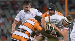Matthew Rea is tackled by Ox Nche and Walt Steenkamp on a miserable night for Ulster.
