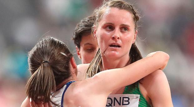 Ciara Mageean is embraced by Scottish runner Laura Muir (left) after a stunning women's 1500m final at the World Championships.