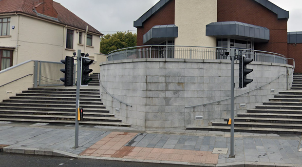 The boys were struck while crossing the road outside St Agnes Church on the Anderstown Road. Credit: Google