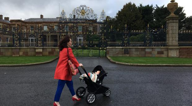 Nichola Mallon pictured taking her infant son to a meeting with the Secretary of State. Credit: Gareth Gordon