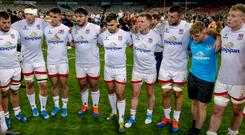 The Ulster players stand together after a disappointing night at the office.