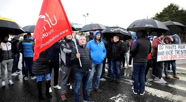 Former Wright Bus Workers outside the factory in Ballymena waiting for news to see if their jobs and the factory have been saved. Credit: Peter Morrison