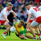 Tyrone's Frank Burns and Matthew Donnelly with Hugh McFadden of Donegal. Credit: INPHO/Tommy Dickson