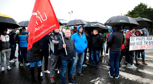 Workers outside the gates of Wrightbus in Ballymena