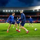 Light training: Northern Ireland's Tom Flanagan, George Saville and Corry Evans limber up under the Rotterdam floodlights last night