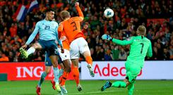 First blood: Josh Magennis heads Northern Ireland in front but a famous win was ripped from their grasp