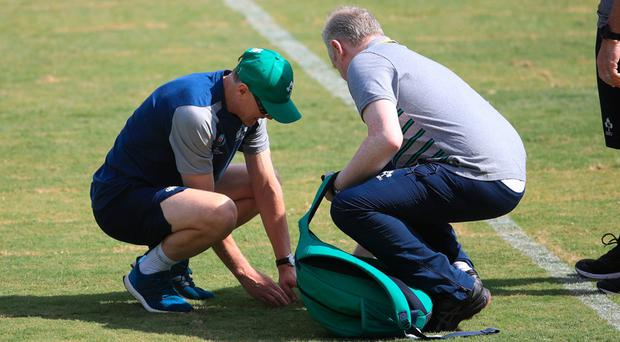 Ireland's Joe Schmidt (left) checks the pitch during the captain's run at Fukuoka Hakatanomori Stadium.