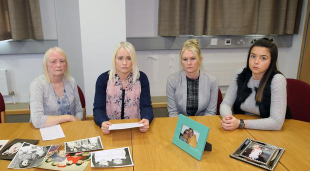 Charlotte Murray's mother Mary, left, and Charlotte's twin sister Denise, making the appeal along with sisters Michelle and Emma. Credit: Peter Morrison