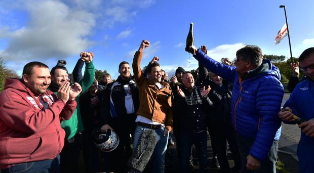 Wrightbus workers celebrate as news breaks that a deal was reached 'in principle' for Wrightbus sale