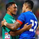 Tusi Pisi of Samoa embraces Bundee Aki after the game.