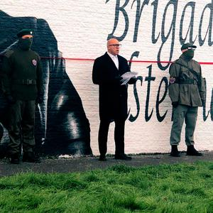 Dee Stitt (centre) addresses supporters at the mural for murdered UDA man Tommy Herron