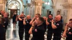 Belfast City Council is investigating the incident in which a loyalist bad marched in City Hall