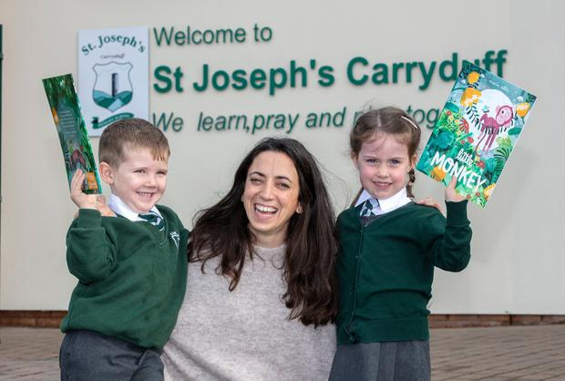 Childrens author and illustrator Marta Altés, with Carryduff St Josephs pupils Fionn O'Rawe and Olivia Forsyth, at an announcement to distribute free books to every primary one child in Northern Ireland.