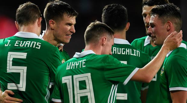 Northern Ireland's defender Paddy McNair (2L) celebrates with teammates after scoring during the international friendly football match between Czech Republic and Northern Ireland in Prague, on October 14, 2019. (Photo by Michal CIZEK / AFP) (Photo by MICHAL CIZEK/AFP via Getty Images)