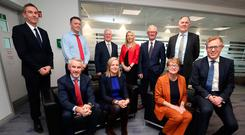 Standing from left: Daryl McIntosh, Padraig Venney, Professor Alastair Adair (chair), Clare McAllister representing sponsors Electric Ireland, Dan Corr and Donal MacRandal. Seated from left: Terry Robb, Arleen Elliott, Susan Mason and Mark Graham