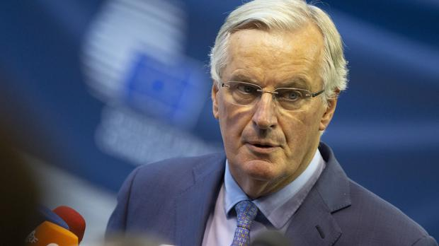 European Union chief Brexit negotiator Michel Barnier speaks with the media as he arrives for a meeting of EU General Affairs ministers in Luxembourg (Virginia Mayo/AP)