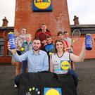 Newcastle Tennis Club Celebrate Big Win with Lidl: Pictured (BR, L-R) celebrating their £4000 win in Lidl's Sport For Good initiative with team coach Sam Clegg, are Newcastle Tennis Club members Anna Torrens, Piera Corrigan, Jamie Magee, Patrick Flanigan and Oliver Corrigan. Celebrating with the team (FR, L-R) are Newcastle Store Manager Alan Rutledge and Paralympics Gold Medal Swimmer Bethany Firth.