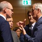 European Union chief Brexit negotiator Michel Barnier, right, speaks with Irish Foreign Minister Simon Coveney, left, in Luxembourg (AP Photo/Virginia Mayo)