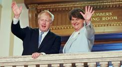 Boris Johnson and Arlene Foster (Niall Carson/PA)