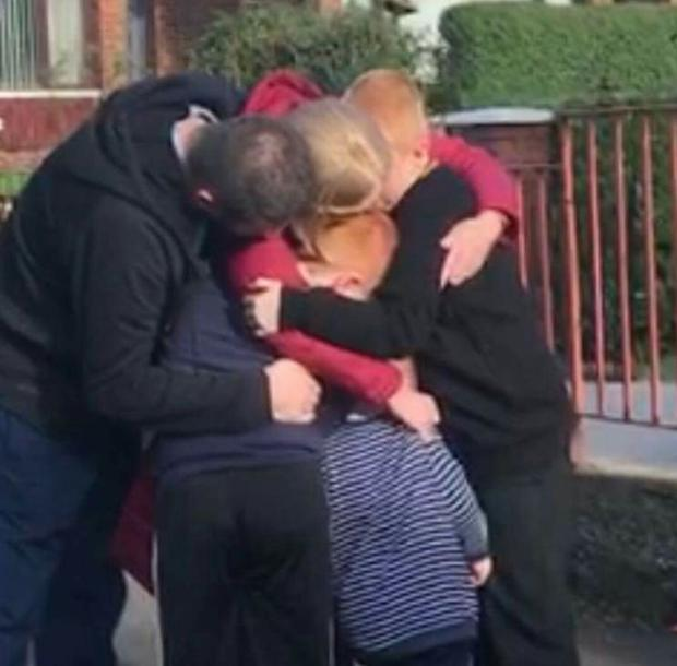 Sharon McCloskey reunited with her family following treatment in Dublin.