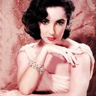 Elizabeth Taylor shows off some of the magnificent jewels she possessed