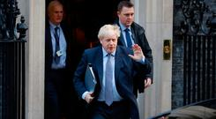 Prime Minister Boris Johnson leaves 10 Downing Street in central London on October 19, 2019.
