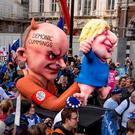 Demonstrators march with an effigy depicting Boris Johnson as a puppet operated by his advisor Dominic Cummings during a rally by the People's Vote organisation in central London on October 19, 2019