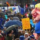 Anti-Brexit protesters pull a float depicting Prime Minister Boris Johnson in Parliament Square (Victoria Jones/PA)