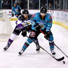 Belfast Giants winger Liam Reddox with Manchester Storm defenceman John Negrin (William Cherry/Presseye)