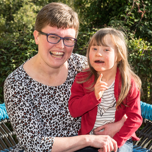 Mummy's girl: Maisie Colhoun with mum Dawn and (below) the six-year-old at play