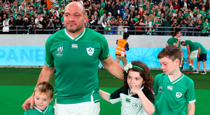 Family occasion: Rory Best leaves the Tokyo stage with his children Ben, Penny and Richie (left)