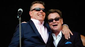 Suggs, performs next to Chas Smash at the Glastonbury Festival 2009 in south west England. REUTERS/Luke MacGregor