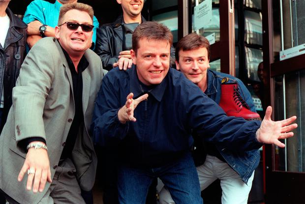 Pop group Madness (from left) Cathal Smyth, Suggs, and Daniel 'Woody' Woodgate at the Dr Martens store in London's Covent Garden to launch the limited edition 1460 boot which is embossed with the band's logo.