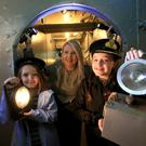 Lousie Carville with Erin McClarty and Ella McLoughlin deep inside HMS Caroline in Belfast.